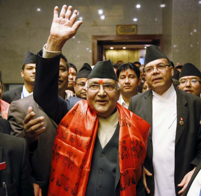 Nepal's newly elected Prime Minister Khadga Prashad Sharma Oli, also known as KP Oli, (C) waves towards the media after he was elected as Nepal's 38th Prime Minister, in Kathmandu, Nepal October 11, 2015. REUTERS/Navesh Chitrakar - RTS3YL5